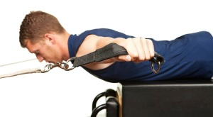 a man performing a Pilates excercise on Reformer