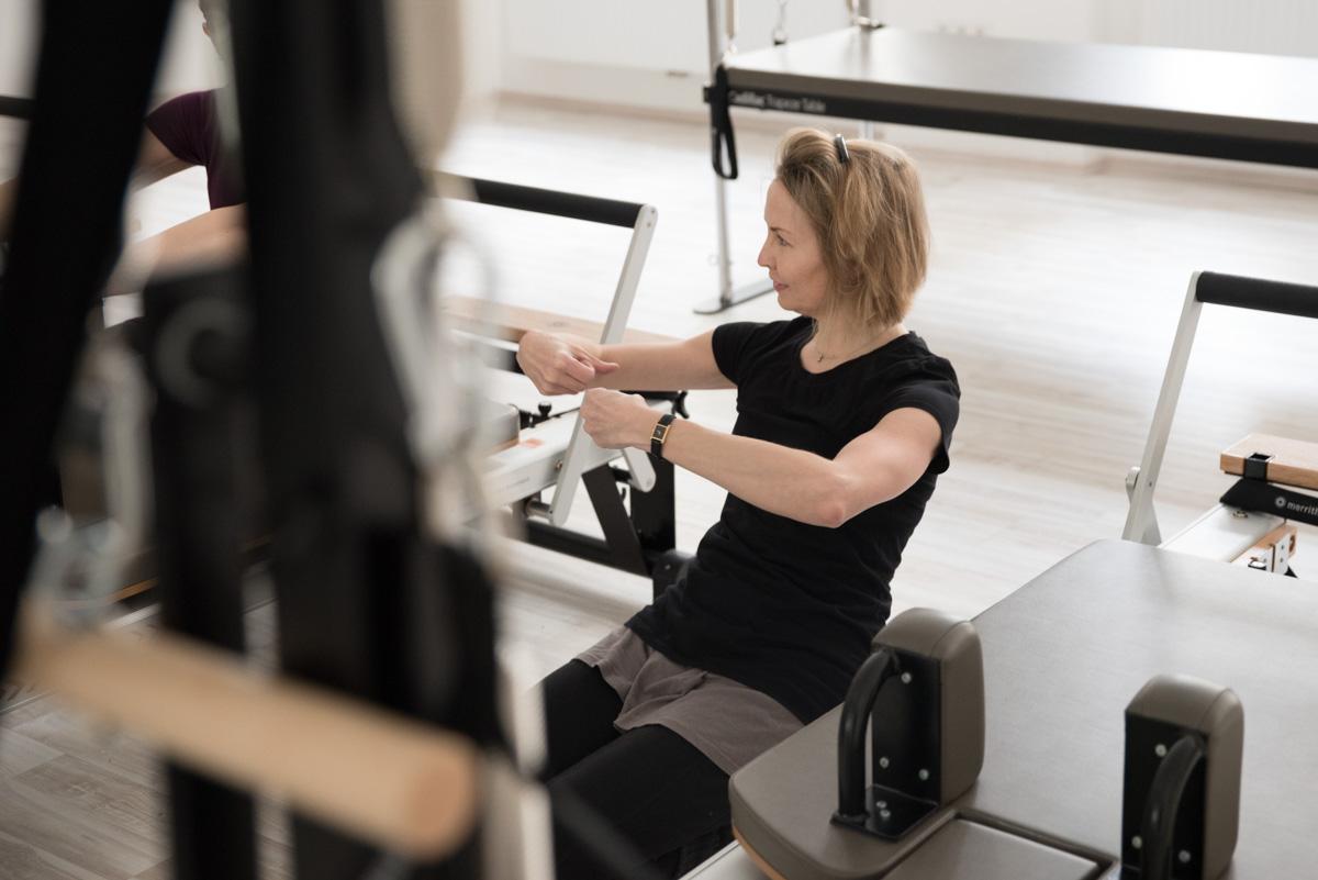 Olga at Core Pilates teaching a class